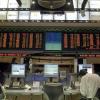 Ações de Petrobras e bancos caem; dólar sobe a R$ 2,52